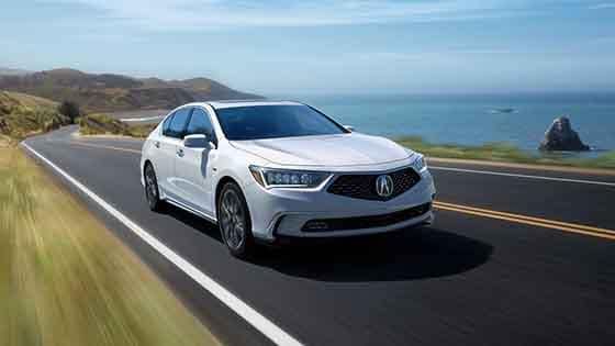 2018 Acura RLX Sport Hybrid driving next to the ocean