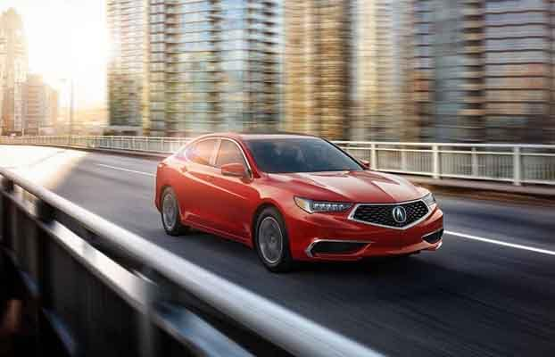 2018 Acura TLX driving down the highway equipped with GPS Climate Control