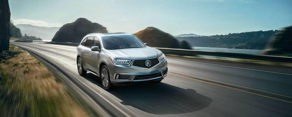 2018 Acura MDX Driving Next To a Lake on the Highway