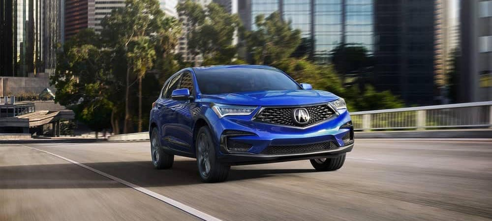 2019 Acura RDX driving blue