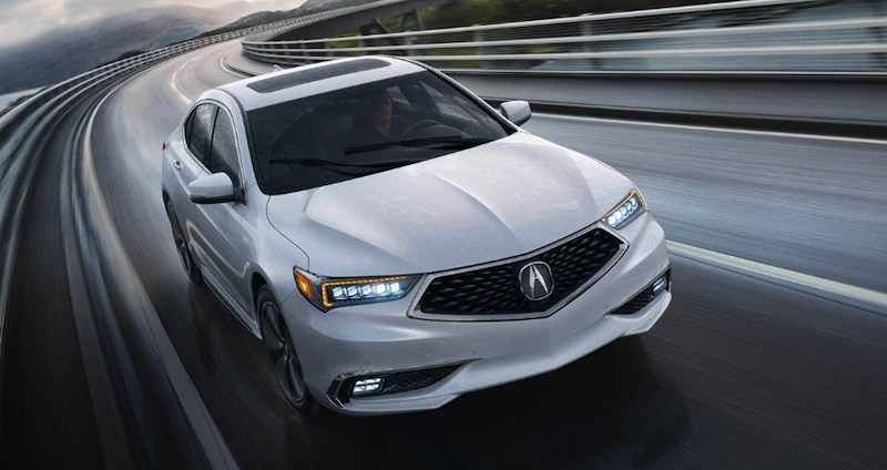 Acura TLX driving fast
