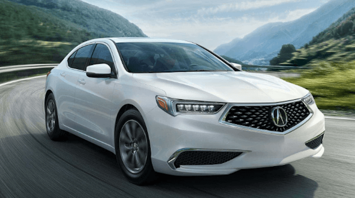 2020 Acura TLX white sedan driving on CT road