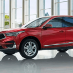 Red 2020 Acura RDX in showroom