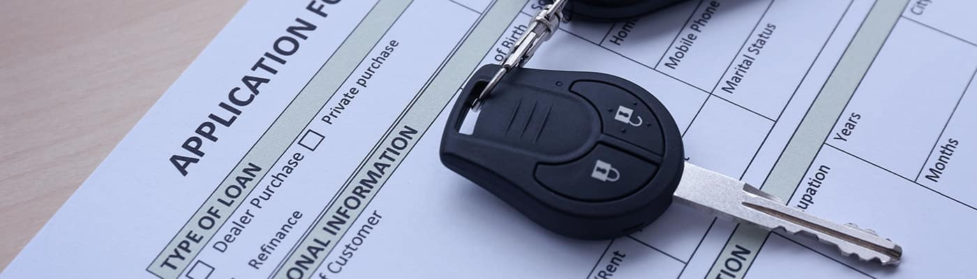 car key resting on loan application