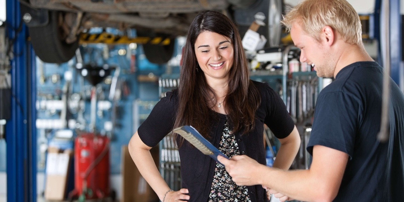 Mechanic Talking to Woman_6478282
