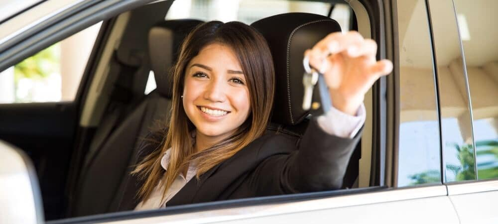 woman smiling and holding her car keys