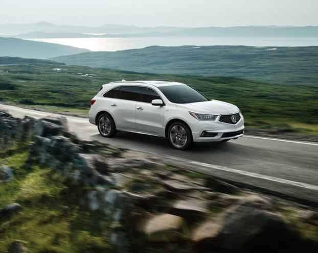 White 2018 Acura MDX Driving on Mountain Road