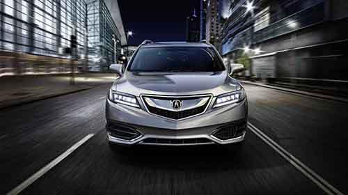 2018 Acura RDX driving through a city street front end view