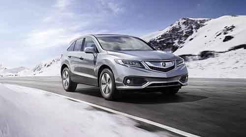 2018 Acura RDX driving through snow covered mountains