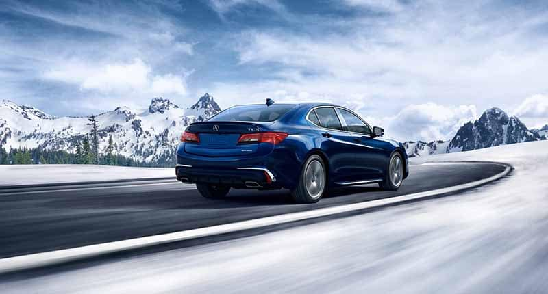 2018 Acura TLX driving through snow covered mountain roads