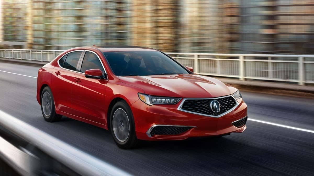 2019 Acura TLX in Milano Red Driving
