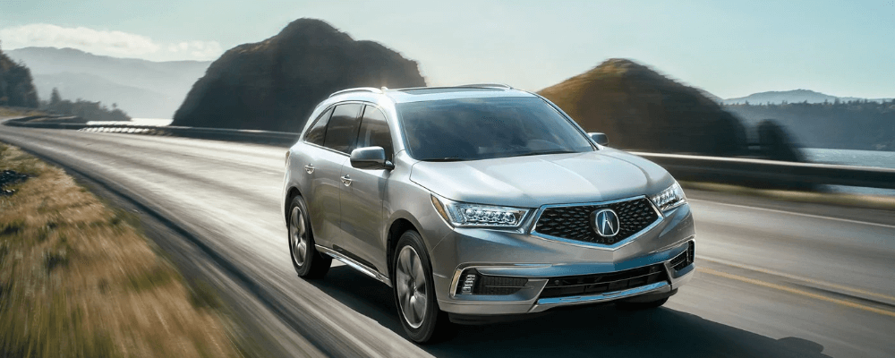 2019 Acura MDX driving on highway 27 mpg