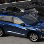 blue 2019 Acura RDX with grey SUVs