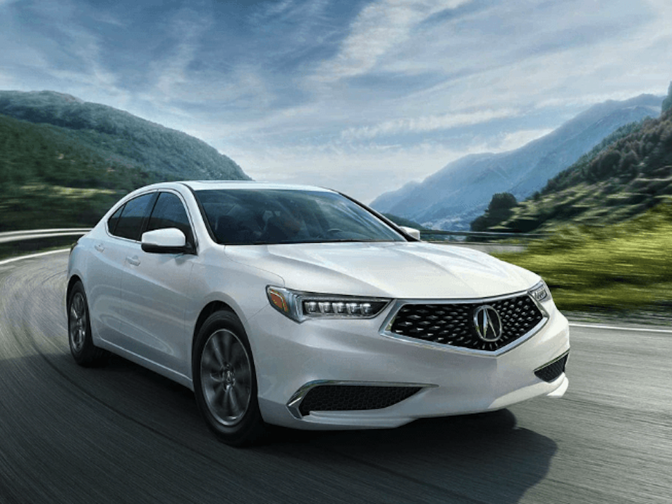 Acura TLX white car on country road