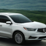 2020 silver acura mdx driving on highway