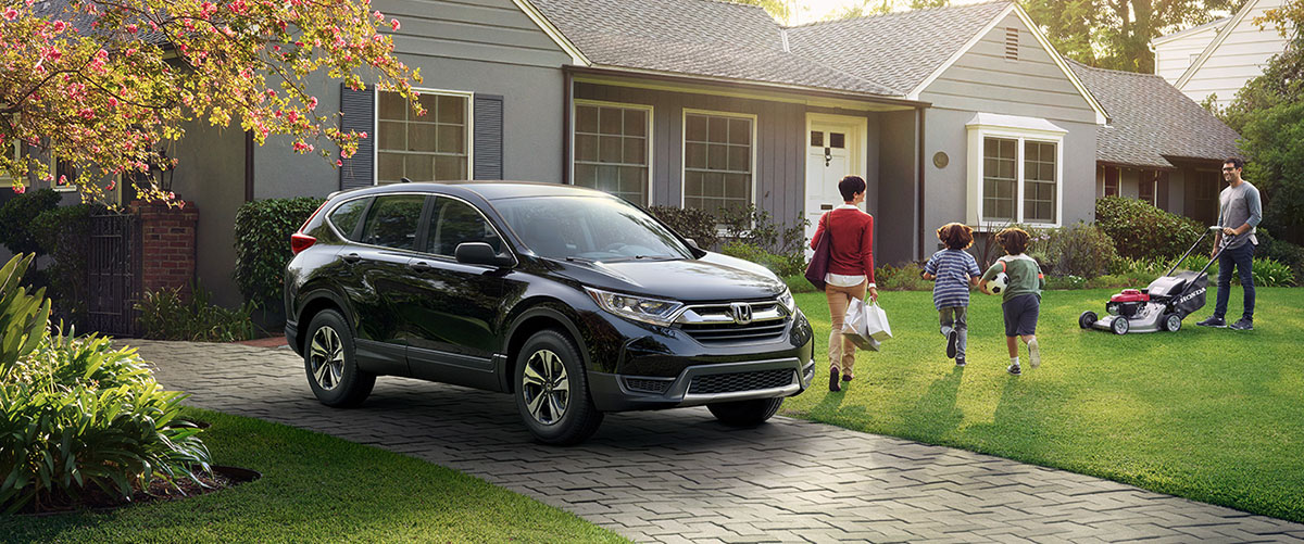 2017 honda cr-v in front of house