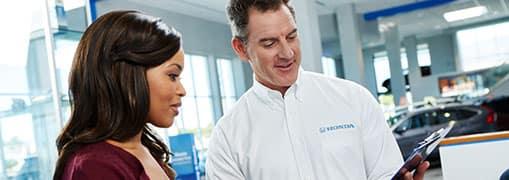 Honda Service Manager Helping Customer
