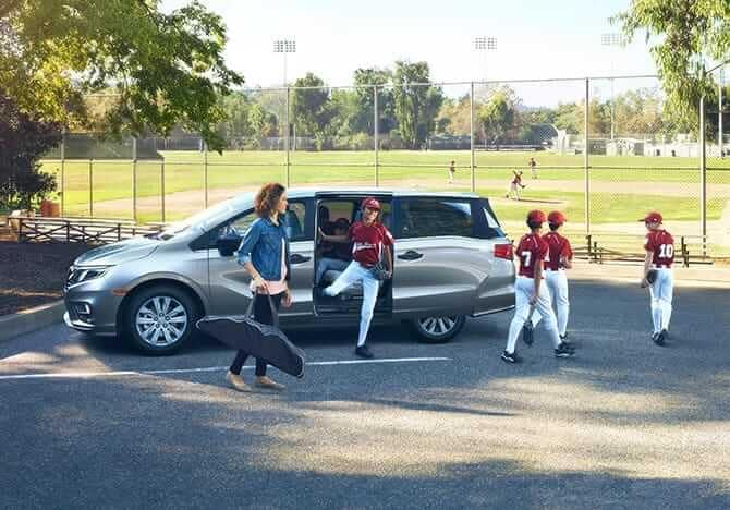 2019 Honda Odyssey parked by a baseball field