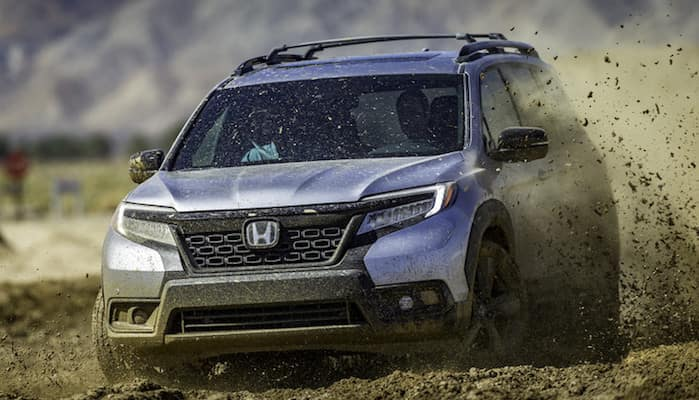 Honda Passport driving through mud