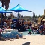 Kids playing on Shane's Inspiration playground