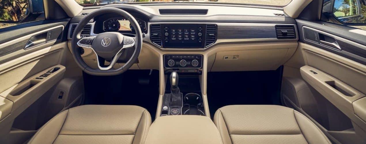 The tan interior of a 2021 Volkswagen Atlas is shown.