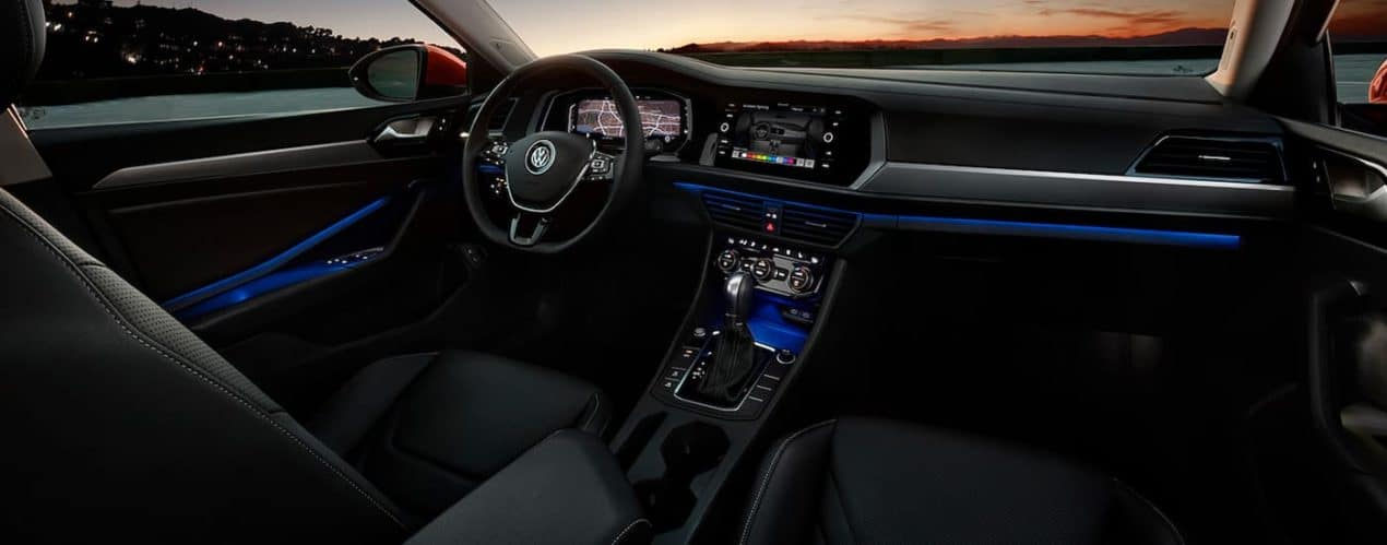 The black interior and infotainment system is shown in a 2021 Volkswagen Jetta.