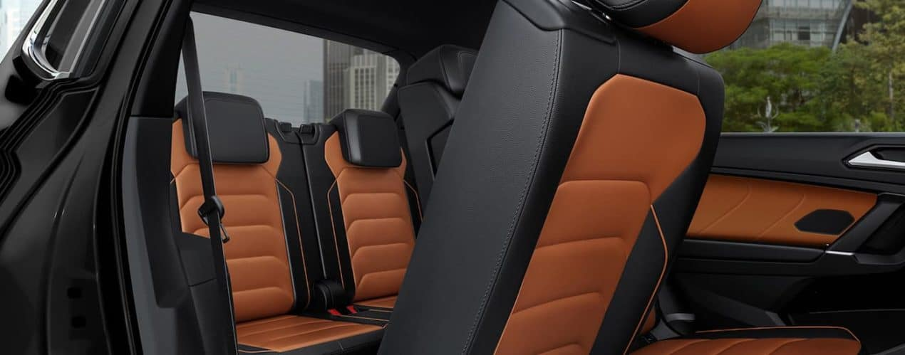 The brown and black seats are shown from the passenger side of 2021 Volkswagen Tiguan.