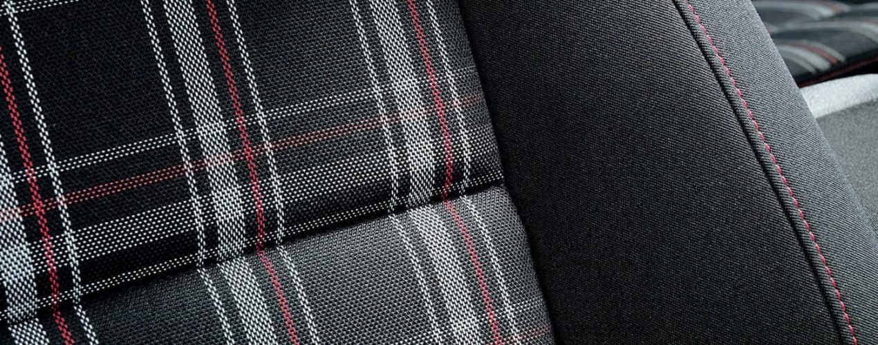 A close up shows the plaid interior in a 2021 Volkswagen Golf GTI S.