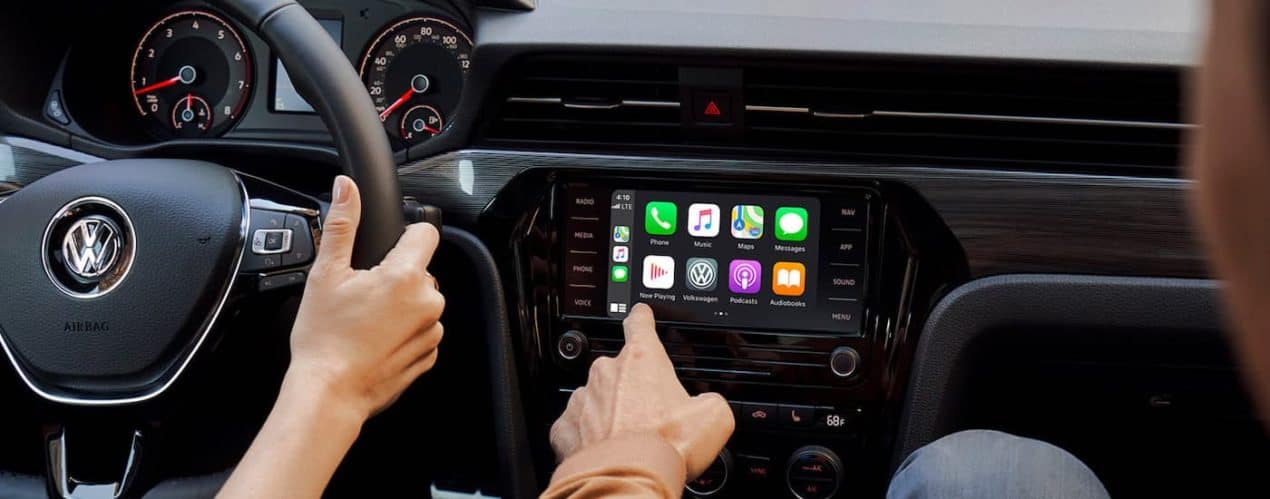 A close up shows someone selecting apps on the infotainment screen in a 2021 Volkswagen Passat R-Line.