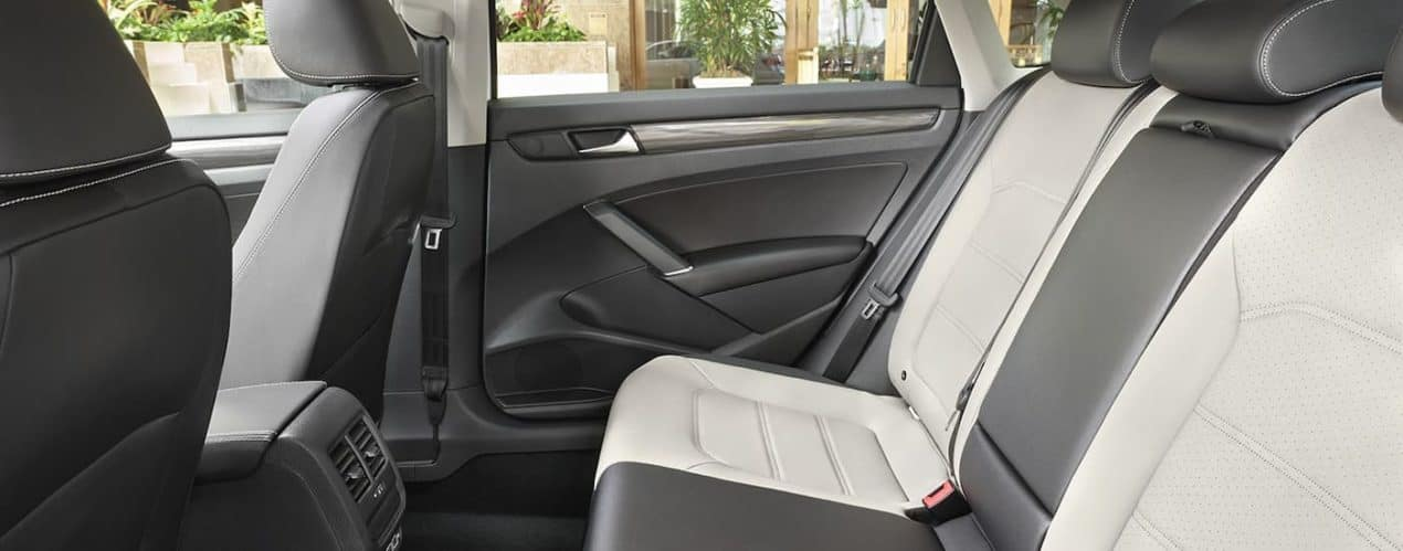 The silver and black leather seats are shown in a 2021 Volkswagen Passat R-Line.