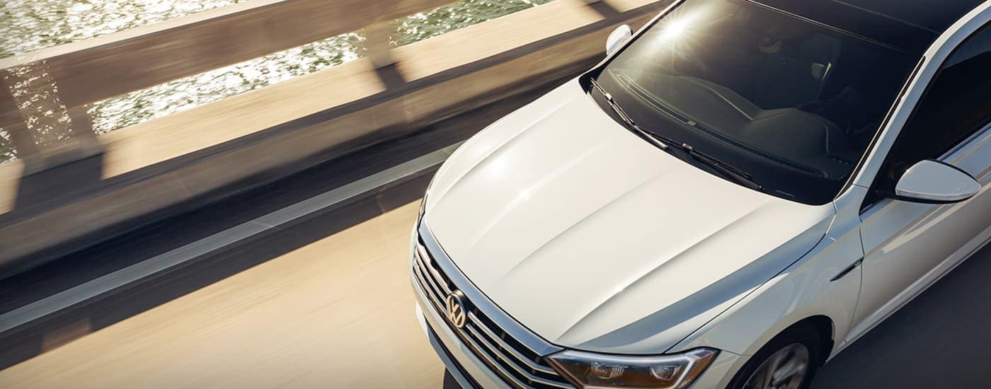 A white 2021 Volkswagen Jetta is shown from above.