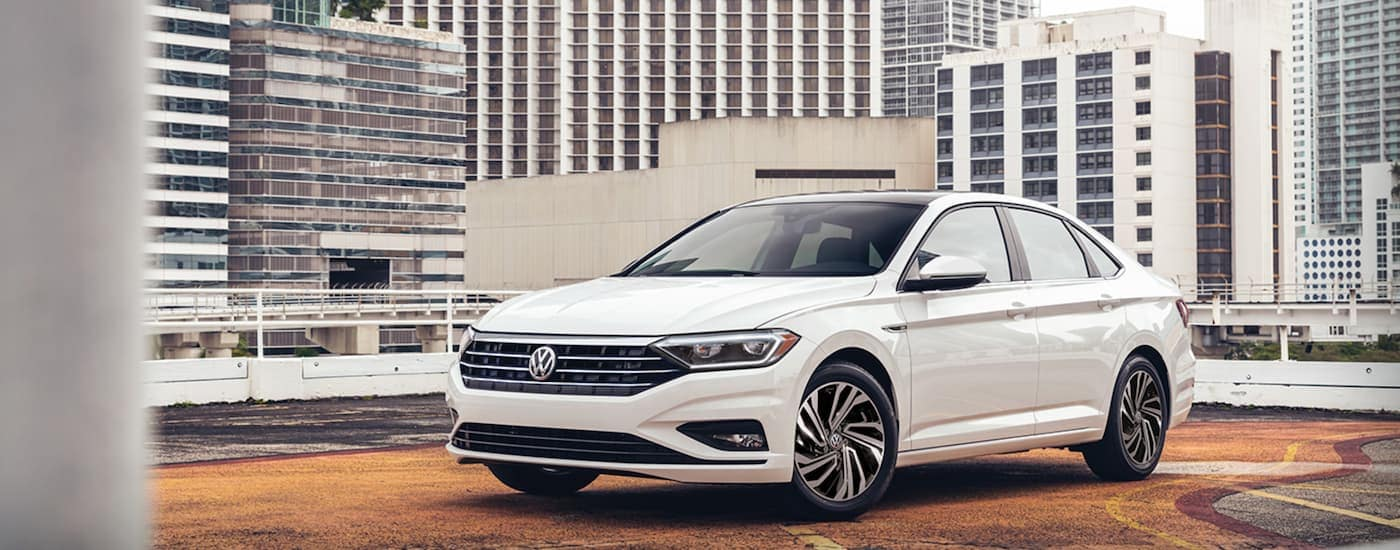 A white 2021 Volkswagen Jetta is on a city rooftop.
