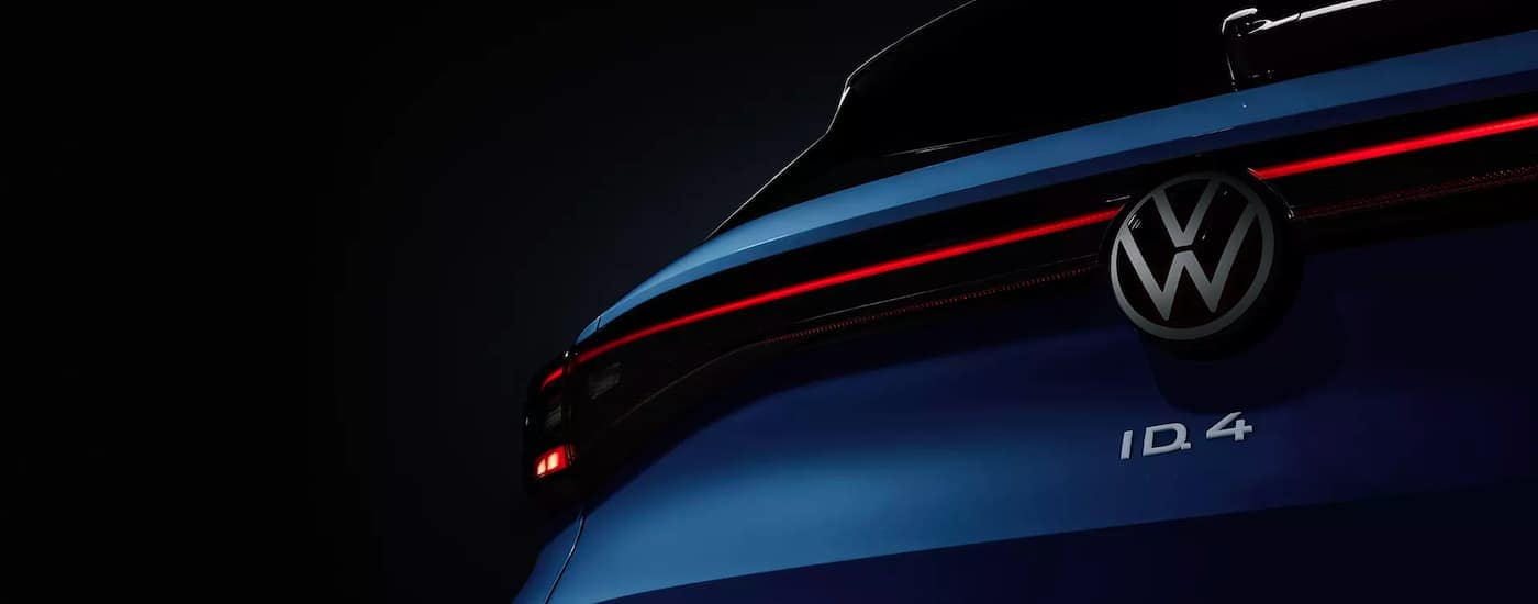A close up shows the badging on the rear of a blue 2021 Volkswagen ID.4.