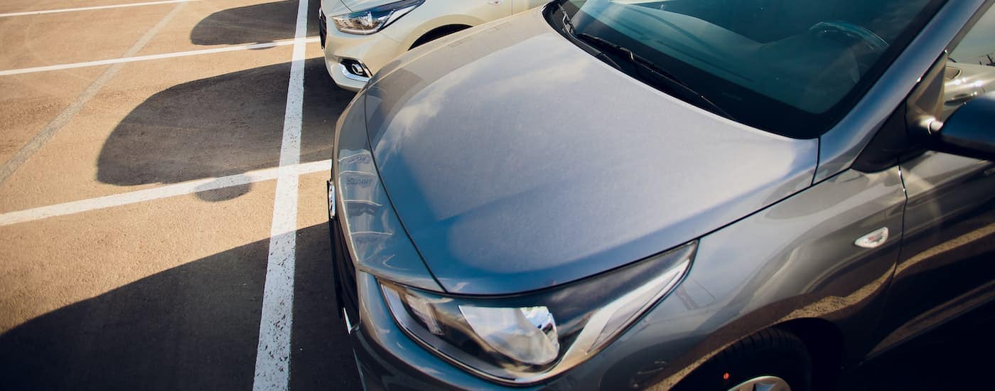 A row of cars is shown on a sunny day.