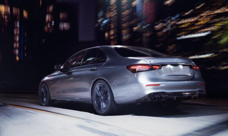 2021 Mercedes-Benz E-Class Sedan exterior city driving away at night