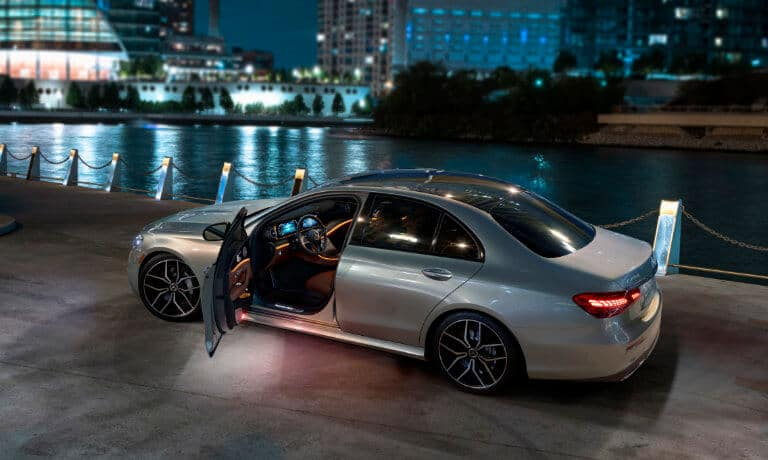 2021 Mercedes-Benz E-Class Sedan exterior driver door open at night by waterfront