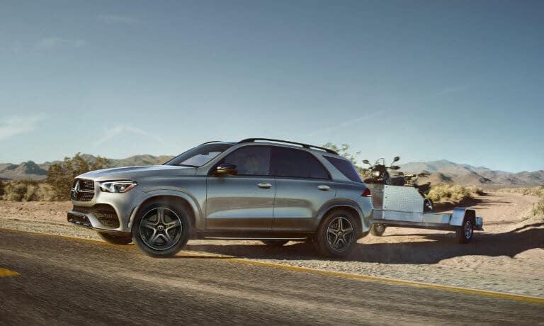 2021 Mercedes-Benz GLE SUV exterior in desert towing trailer