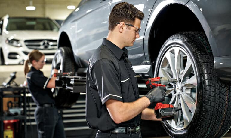 Mercedes-Benz service technicians working on tires