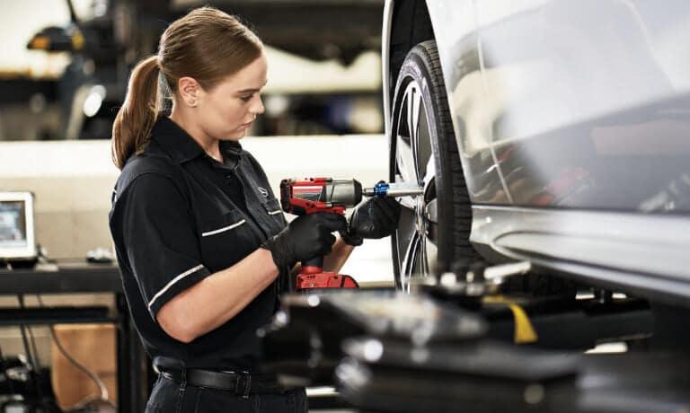 Service technician removing tire