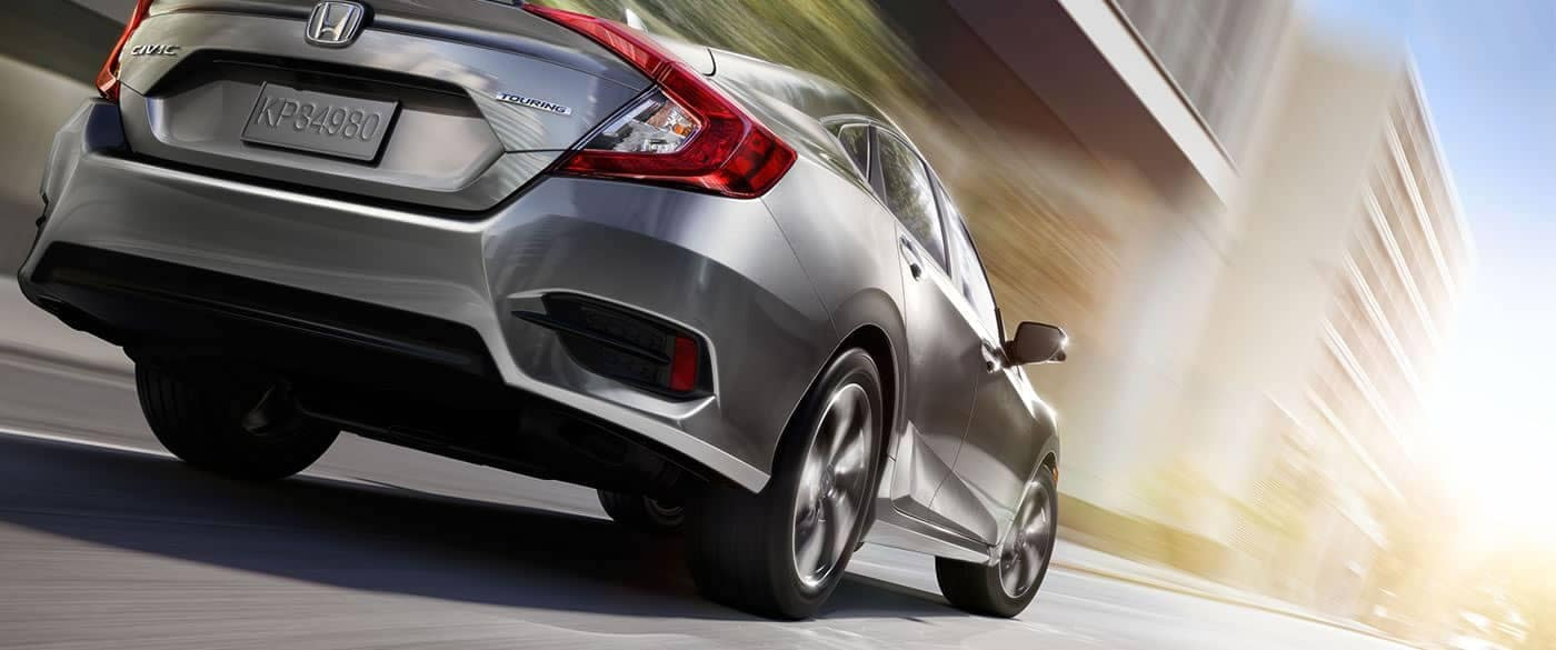 2018 Honda Civic rear view driving in the city