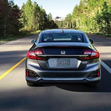 2018 Honda Clarity rear view driving down the street