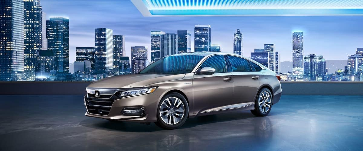 2019 Honda Accord Hybrid with City in the Background