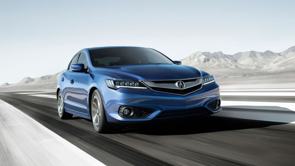 blue ILX driving on road