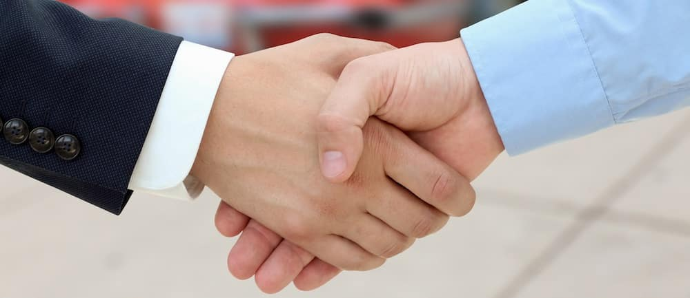 Close-up image of a firm handshake  after a successful deal of financing or leasing a car