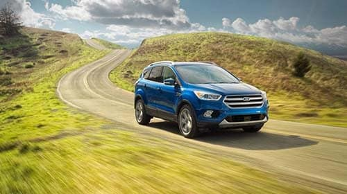 2017 Ford Escape driving down country road