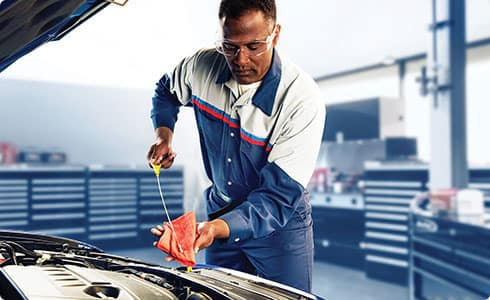Ford Technician Doing Maintenance on Car