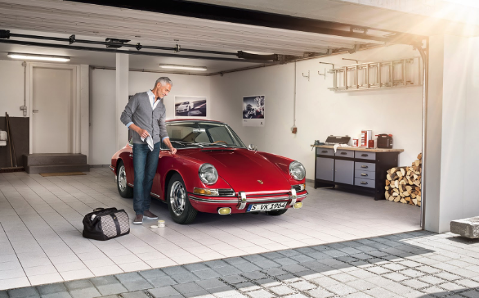 Man cleaning his sports car in the garage