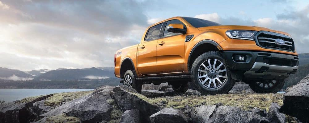 Orange 2019 Ford Ranger Parked upon a mountain top at dawn