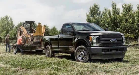 2019 Ford F-250 Towing a Operating Machine
