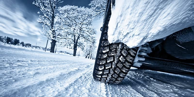 Close up of tire driving in snow